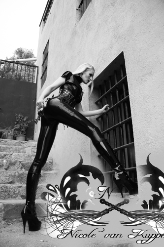 Mistress in full clad latex guards the 24/7 slaves