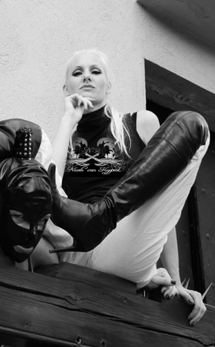 masked slave with Mistress high heeled boots to his head